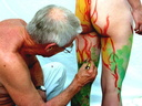 Nude body painters in action 35