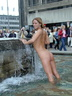 nude in city fountain 1